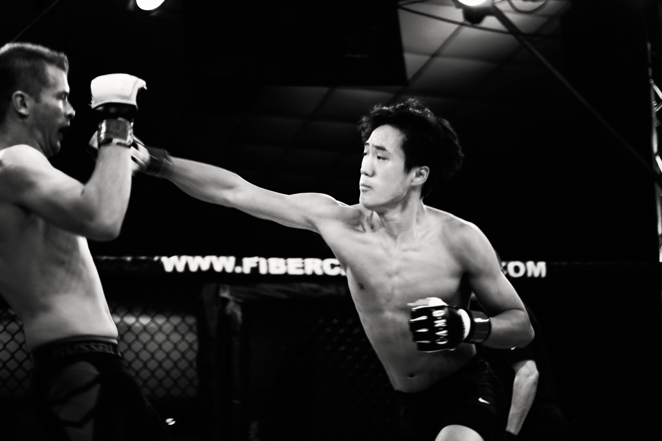 John Kim throwing a punch in the ring on CFL VIII
